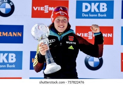 Holmenkollen, Norway - MARCH 19, 2017: Laura Dahlmeier of Germany gets big crystal globe in the biathlon total score at the BMW IBU World Cup Biathlon 9
