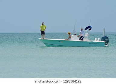 Holmes Beach, Anna Maria Island FL / USA - April 30, 2018: People Fishing from a Power Boat in the Gulf of Mexico