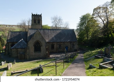 Holmfirth, UK - April 21 2020: St John's Parish Church in Holmfirth which houses the graves of Last of the Summer Wine actors Bill Owen and Peter Sallis.