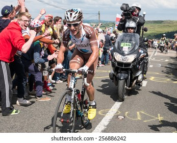 Holmfirth, UK - July 6th, 2014: The peloton of the Tour De France climbs Holme Moss, near Holmfirth, Yorkshire