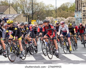 Holmfirth, UK - May  3rd, 2015: The peleton of the 2015 Tour de Yorkshire cycle race passes through the town of Holmfirth