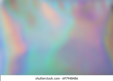 Holographic background gradient shades, iridescent rainbow colors. Out of focus photography, perfect as backdrop for your design.