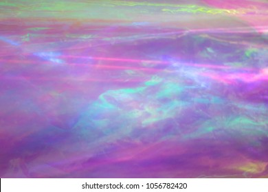 Holographic background. Light reflection, rainbow colors, psuchedelic pattern. Magical marbling and iridescent effect for banner templates and wallpapers. Pink shades