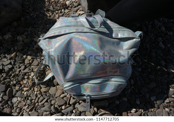 holographic backpack on gravel