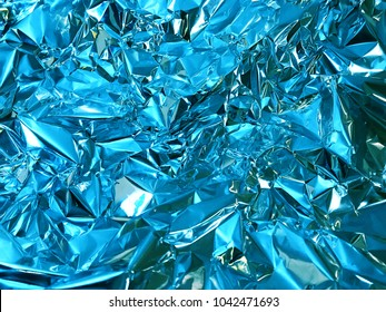 Holographic blue color wrinkled foil. Hologram background of wrinkled abstract foil texture with colors and shiny background