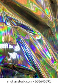 Holographic color wrinkled foil. Holographic colorful psychedelic image taken from real foil. Very colorful holographic  foil. Multicolor surface with super bright texture. Hologram textue