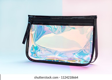Holographic colors cosmetic bag on pastel tones background