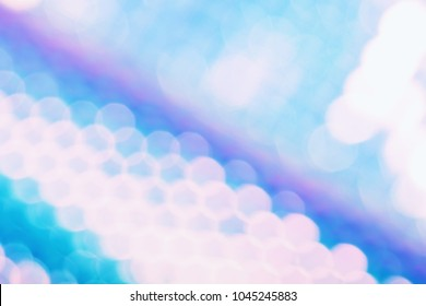 Holographic foil background with trendy holo color style and sparkly bokeh light and glitch effect. Multicolor wallpaper.
