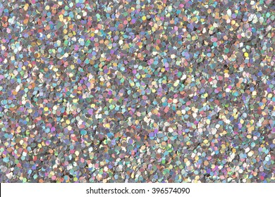 Holographic glitter texture. Low contrast photo.