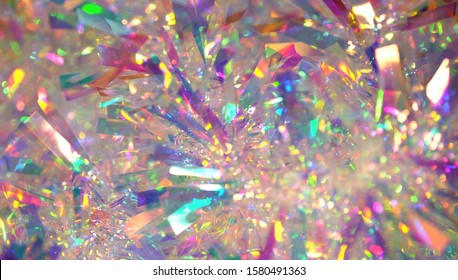 Holographic iridescent tinsel. Hologram Background of abstract shiny foil texture with rainbow colors. Neon pastel gradient of real surface