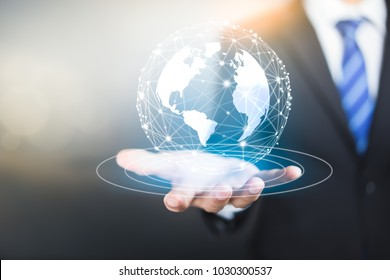 Holographic projection of Earth above mans hand, World connected.Social network concept.