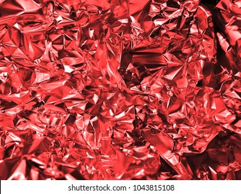 Holographic red color wrinkled foil. Hologram background of wrinkled abstract foil texture with colors and shiny background. Good for christmas cards.