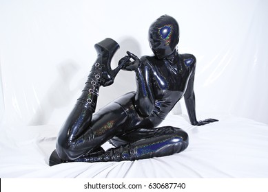 holographic zentai catsuit masked woman on white background isolated