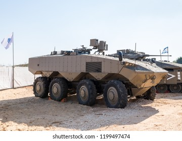 """Holon, Israel, 27 September, 2018 : Protected fighting vehicle Puma for the transport of soldiers consisting of military weapons at the army exhibition """"Our IDF"""""""