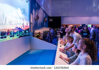 """Holon, Israel, 27 September, 2018 : Visitors use visual simulators under the supervision of an army instructor at the army exhibition """"Our IDF"""""""