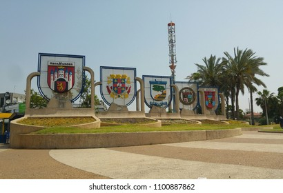 HOLON, ISRAEL. April 13 2018. Coats of arms of Holon twin cities in Europe and other places. A sign at the entrance to Holon, a city south of Tel Aviv. Warriors square, also known as the Tears square.