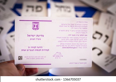 HOLON, ISRAEL. April 9, 2019. An invitation in Hebrew to take part in the Israel parliamentary elections to the Knesset. Ballot papers on the background. Israel elections 2019 to twenty first Knesset.