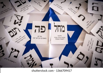 HOLON, ISRAEL. April 9, 2019. Ballot papers of two main rival political parties in the Israel parliamentary elections 2019 to the 21st Knesset: Blue and white (Kahol Lavan) and Likud.