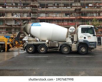HOLON, ISRAEL. December 16, 2020. Concrete mixer and crane at the construction site on Aharonovich street in central Holon. City renovation plan, urban development program.