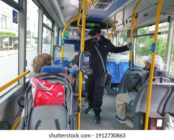 HOLON, ISRAEL. February 8, 2021. Bus inspection in the Dan passenger bus. Comptroller checking bus tickets.