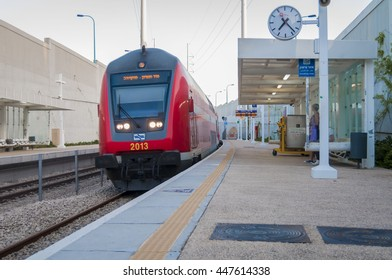 HOLON, ISRAEL. June 2016. Red intercity train arrives to the Holon Wolfson railway station. Israel train stock image. On time, Rakevet Israel, infrastructure works.