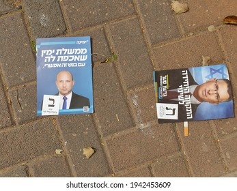 HOLON, ISRAEL. March 24, 2021. Naftali Bennett of Yamina and Gideon Saar of The new hope election flyers. Political ads left on the street after the Israel Knesset elections 2021.