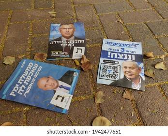 HOLON, ISRAEL. March 24, 2021. Political propaganda flyers of three Israeli right wing politicians Benjamin Netanyah, Gideon Saar and Naftali Bennett left on the street after the Israel elections 2021