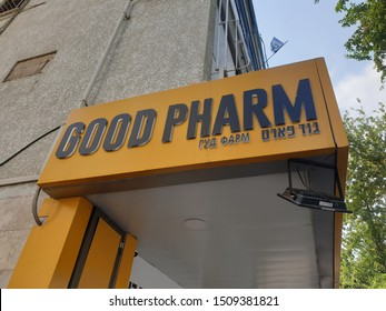 HOLON, ISRAEL. September 19, 2019. Yellow exterior view with a logo and entrance to the Good Pharm pharmacy chain store in the downtown Holon.