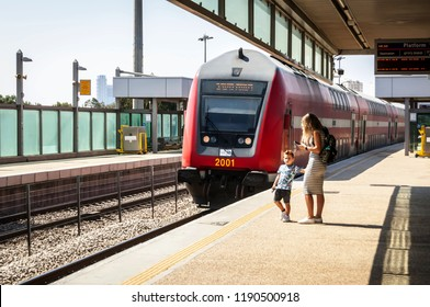 HOLON, ISRAEL. September 27, 2018. Mother and child at the platform waiting for the arriving train. Danger, risk, too close to the edge of the platform.