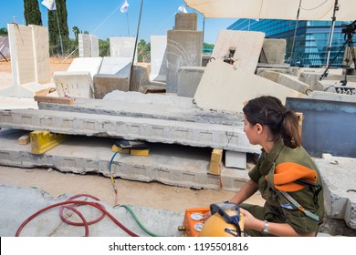 HOLON, ISRAEL - SEPTEMBER 28, 2018: Girl soldier from IDF Search and Rescue unit show working with air lifting bag