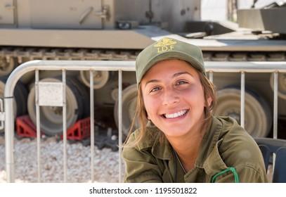 HOLON, ISRAEL - SEPTEMBER 28, 2018: Unidentified israeli girl soldier as presenter on military show