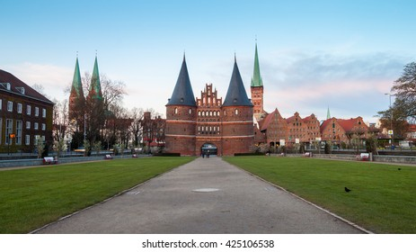 Holstentor Gate during twilight in Lubeck, Germany