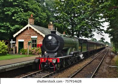 HOLT, NORFOLK, ENGLAND - AUGUST 9, 2017: A restored locomotive working the North Norfolk railway line.