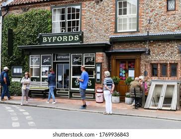 Holt, Norfolk / UK - July 5 2020: Socially distanced queue outside Byford restaurant