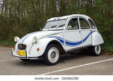 Holten, The Netherlands - April 8, 2018: Citroën 2CV (deux chevaux) parked by the side of the road in the town of Holten. Nobody in de vehicle.