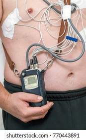 A holter device connected to a man for cordial measurements