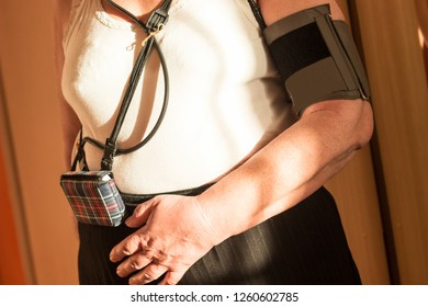 Holter monitor device on a senior patient