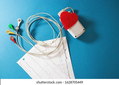 Holter monitoring device on blue  background. Soft focus.