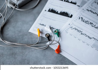 Holter monitoring device on gray background. Soft focus.