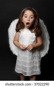 Holy angel singing carols, psalms or praising or worshipping.