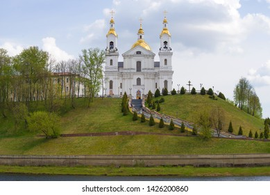 Holy Assumption Cathedral on the bank of the Western Dvina on a cloudy May day. Vitebsk, Belarus