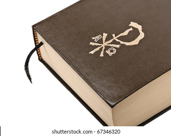 Holy Bible with chi rho symbol on the leather cover, and a page marker