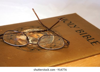 Holy Bible and glasses