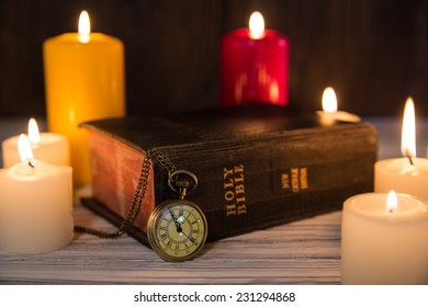 Holy Bible on candle background
