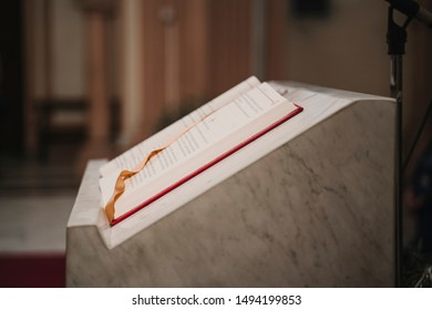 holy bible on table during a wedding ceremony nuptial mass. Religion concept. Catholic eucharist ornaments for the celebration of the Eucharist