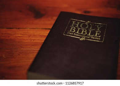The Holy Bible on  wooden background, Holy spirit and read bible and anointing concept.
