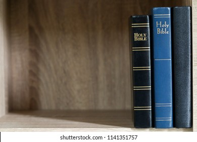 Holy Bible on a wooden bookshelf. Holy Bible background. Christian background. Christianity concept. Faith hope love concept.