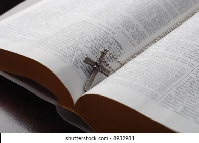 holy bible open with a cross on it