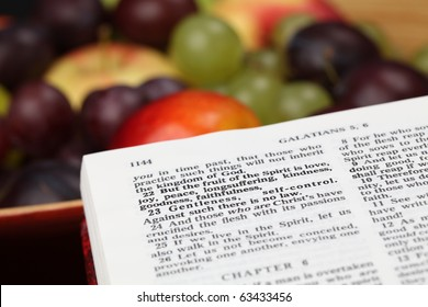 Holy Bible open to Galatians 5. Focus on verse 22. Fruit of the Spirit.