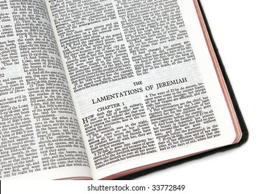 holy bible open to the the lamentations of jeremiah, on white background